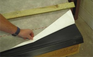 Felt-support trays at eaves with underlay set back.
