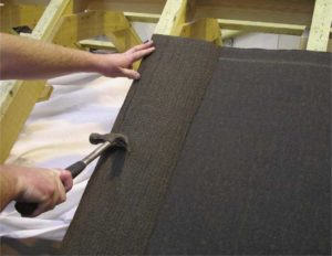 Fold or cut off the underlay back where it overhangs a rafter.