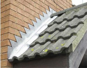 Step and cover roof flashing for interlocking tiles.